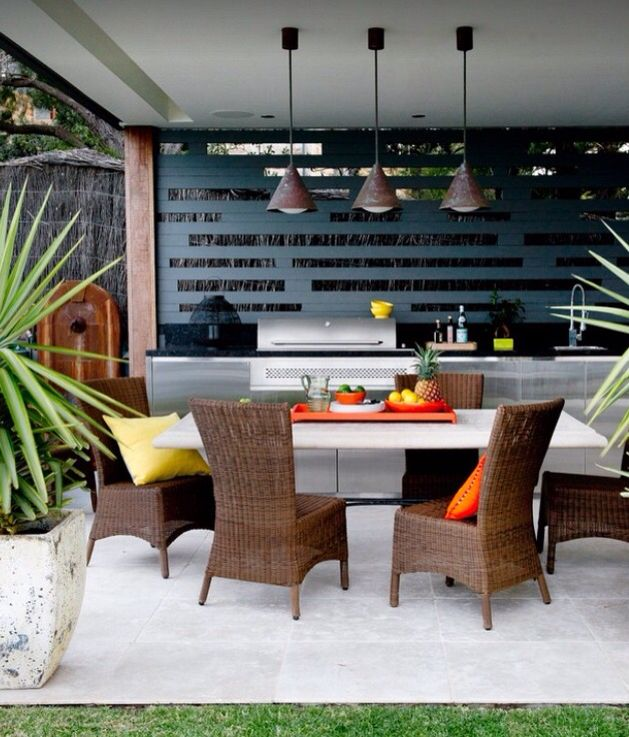 Cut out metal design screening is a strong feature in this alfresco. The grey contrasts well against the warmth of brown, orange and yellow. Photo credit- Point 2 Design