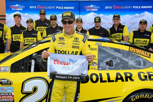 Matt Kenseth, #20 Dollar General Toyota, poses with the Coors Light Pole Award after qualifying for the NASCAR Sprint Cup Series Pure Michigan 400 at Michigan International Speedway on August 14, 2015 in Brooklyn, Michigan.