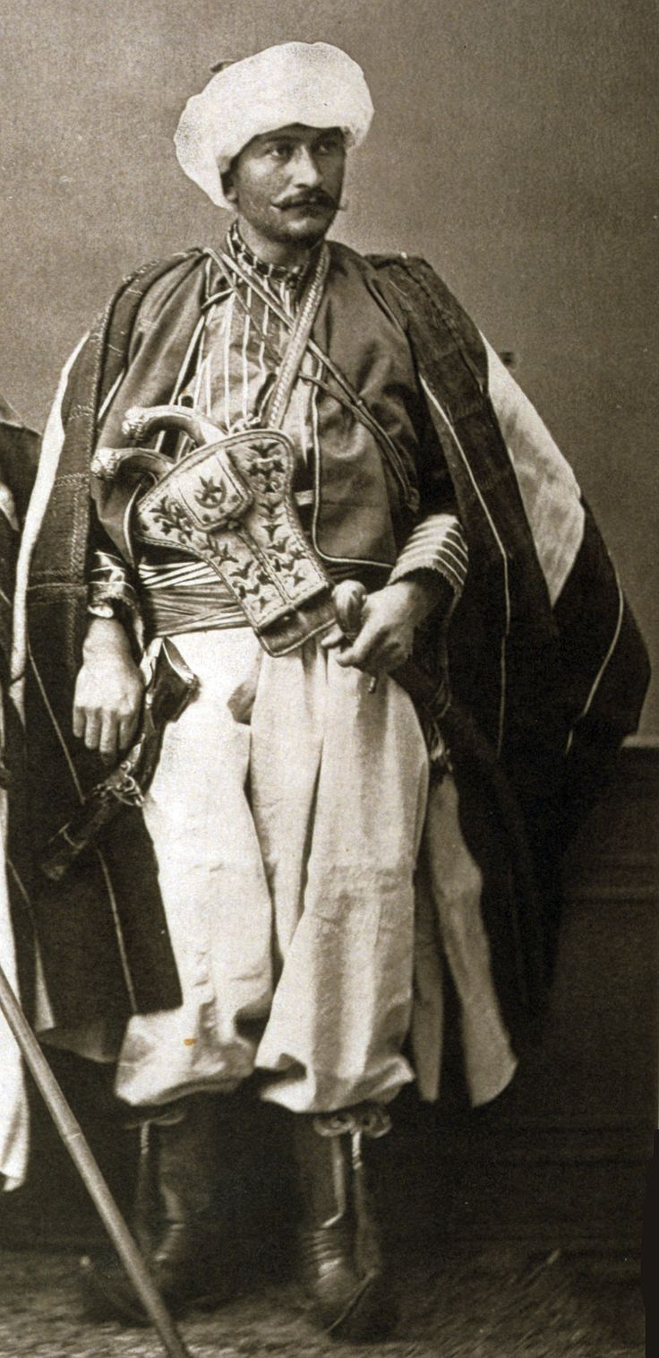 "Druse of Ottoman Lebanon shown wearing a holster (kuberluk) with two pistols (kuber, a kilij sword and blunderbuss. From:Les costumes populaires de la Turquie en 1873, 74 photographic plates by Pascal Sebah, published by the Imperial Ottoman Commission for the ""Exposition Universelle"" of Vienna in 1873."