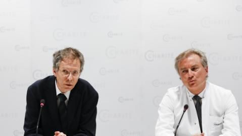 Christoph Buehrer, left, director of neonatology at Charite Hospital and Wolfgang Henrich, director of    Babies of 65 year old woman, still in critical condition. gynecology at Charite Hospital, brief the media about the situation of 65-year old mother Annegret Raunigk and her quadruplets, in Berlin, Germany, Wednesday, May 27, 2015. The 65-year-old teacher from Berlin has given birth to a girl,Neeta and three boys, Dries, Bence and Fjonn, by cesarean section at the hospital on Tuesday May…
