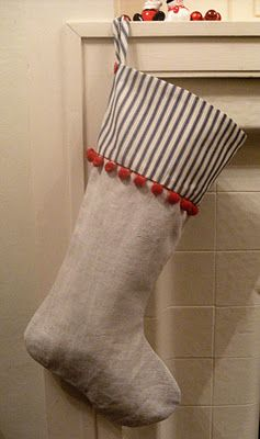 Christmas Stocking of Old French linen, old ticking and lovely red bobbles via Sew Good by Deborah Good: Christmas Stockings .....and a tutorial.