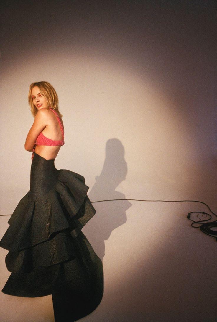 Margot Robbie wears Prada top and Rosie Assoulin skirt
