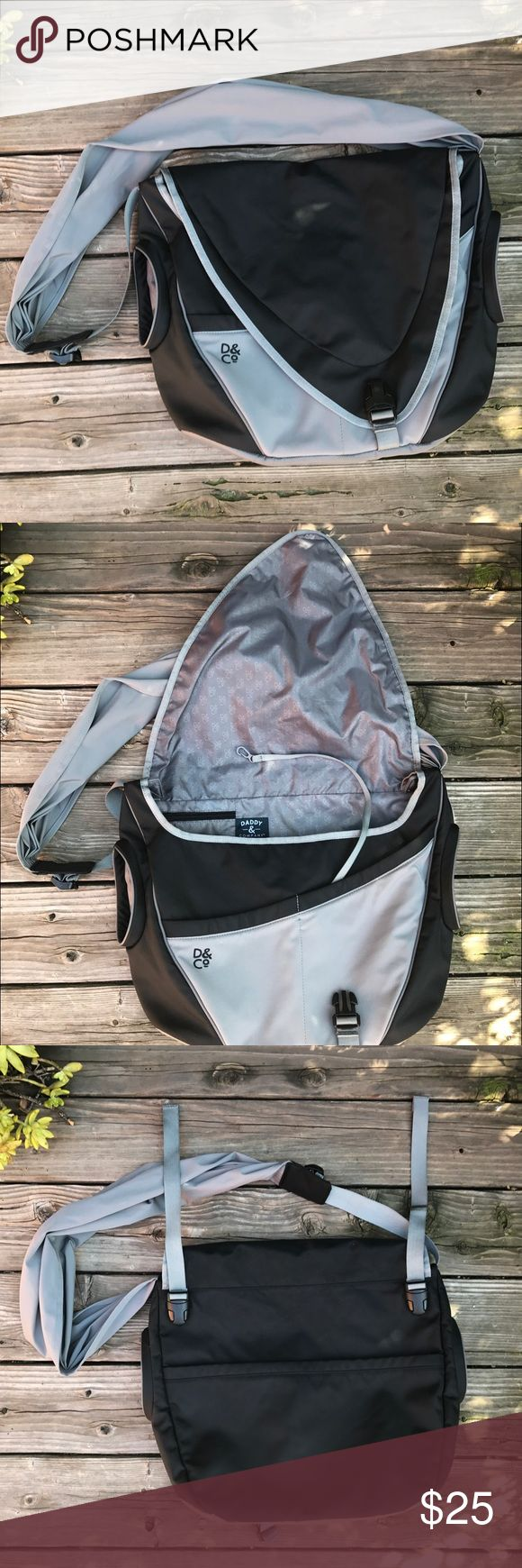 Daddy & Company diaper bag Very comfortable diaper bag for men or women. The back has stroller straps with open pocket. The sides have open pockets for bottles. Inside has multiple pockets with divider. Note: right side pocket for bottle does have stains(see 5th picture) Daddy & Company Bags