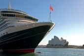 The Queen Victoria cruise ship, docked in Sydney Harbour, with the Sydney Opera Houe in the background