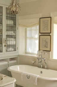 French elegance via Canadian House and Home.    Chandelier & cabinet.  (Tub & faucet go w/o saying).