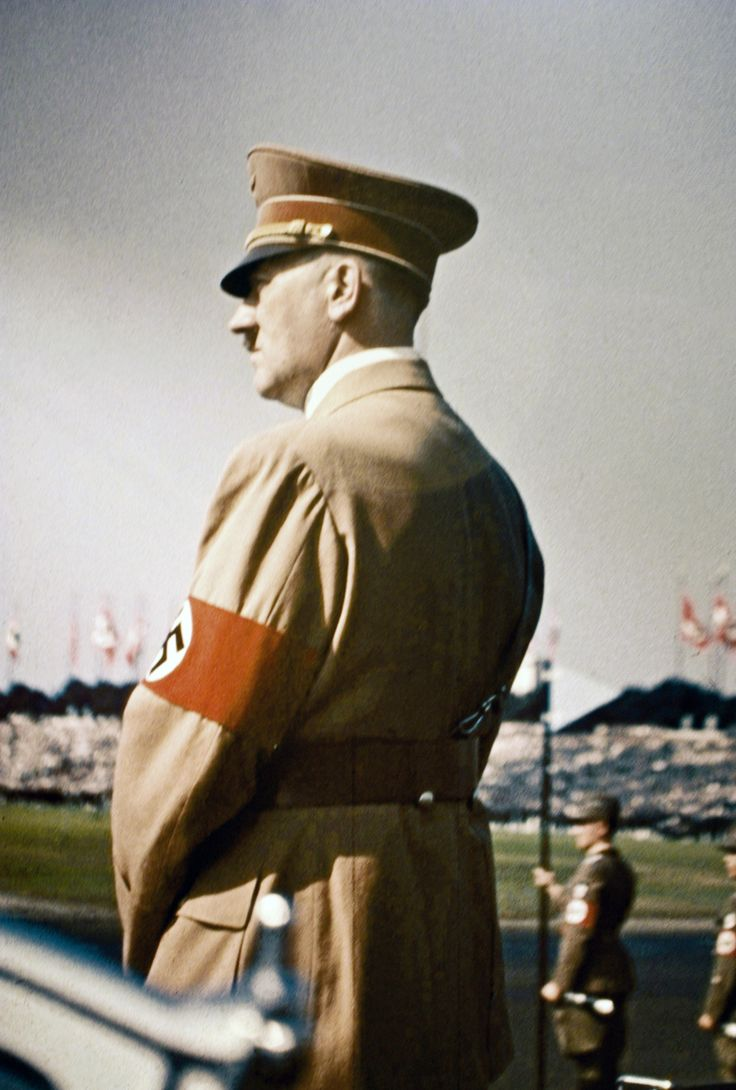 Color photo of Hitler looking on at a Nuremberg Rally