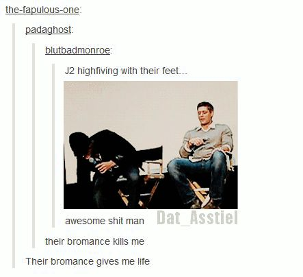 J2 highfiving with their feet