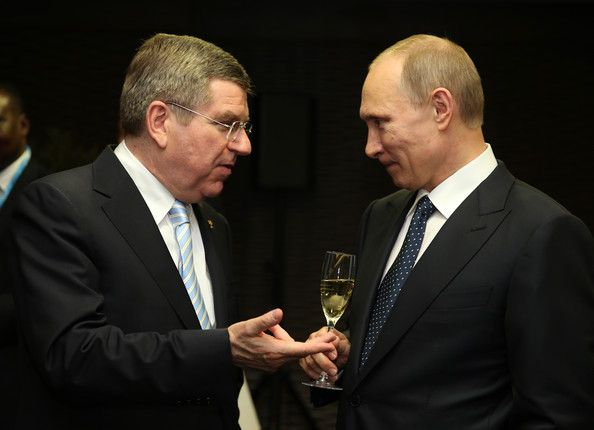 Vladimir Putin Photos Photos - (L-R) Thomas Bach the President of the International Olympic Committee speaks with Vladimir Putin the President of Russia prior to the Opening Ceremony of the Sochi 2014 Paralympic Winter Games at Fisht Olympic Stadium on March 7, 2014 in Sochi, Russia. - Paralympic Winter Games Opening Ceremony