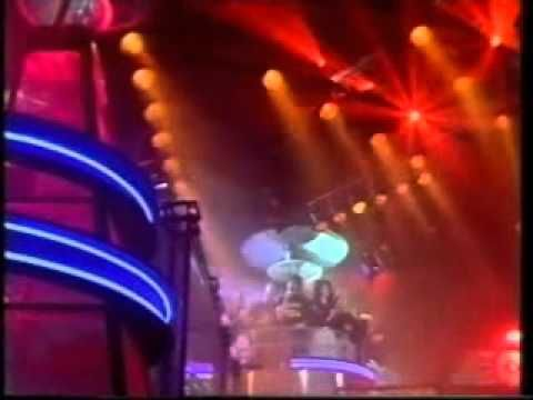 Top of the Pops (TV Show) 80's: Thursday night TV not to be missed if you were a teenager in the 80's in the UK. Sometimes a cool video, lots of lip-syncing and a dance number by Hot Gossip all hosted by one of Radio 1's stable of middle aged DJs. Why was it so influential again?