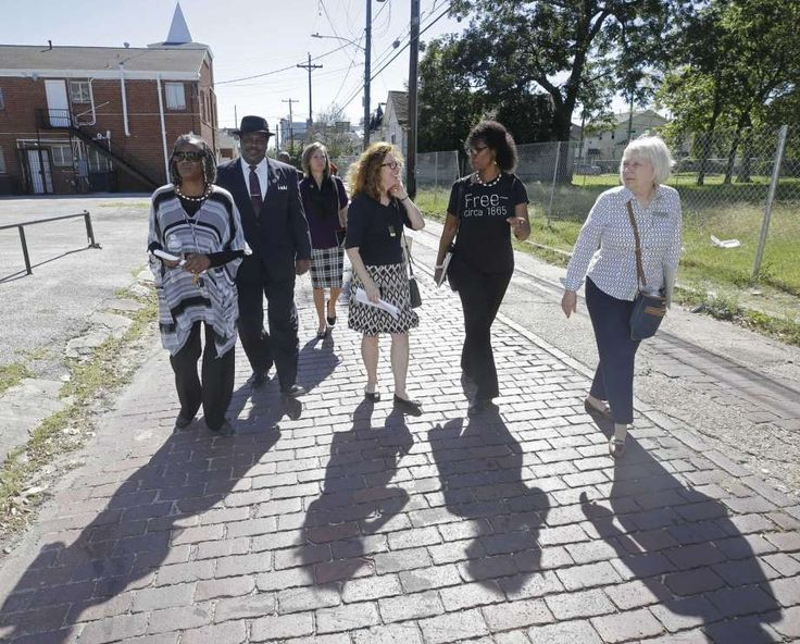 Sarah Trotty, left, Elmo Johnson, pastor of Rose of Sharon Missionary Baptist Church, Jessica Bacorn, with Houston First, Jane Landers, a UNESCO slave-route project representative, Debra Blacklock-Sloan, and Catherine Roberts, with Yates Museum, right, walk on the historic bricks on Wilson St. as they tour Freedmen's Town Thursday, Oct. 26, 2017, in Houston. Photo: Melissa Phillip, Houston Chronicle / © 2017 Houston Chronicle