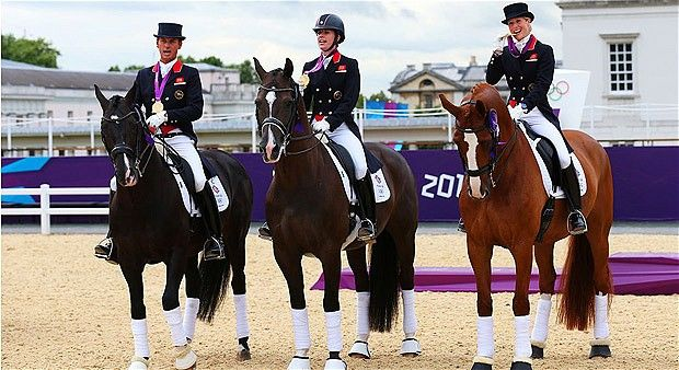 Carl Hester on Uthopia, Charlotte Dujardin on Valegro and Laura Bechtolsheimer on Mistral Hojris celebrate with their gold medals, London 2012 - Telegraph