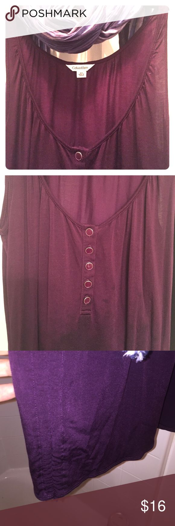 Deep Purple Long Calvin Klein Tank Long deep purple Calvin Klein extra small tank. Tank is longer with runched sides. Buttons going down scoop of collar. Condition like new. Color non faded .. perfect! No holes or rips. Great everyday shirt or lounging. You can also dress it up for a night out with belt and jeans or skirt throw a light jacket over it or crop sweater and you are ready to rock this tank your way! Calvin Klein Collection Tops Tank Tops