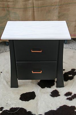 Sleek Coal Black Bedside Table with White Wash Top & Copper Handles