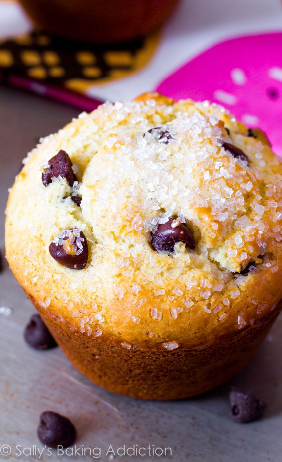 A recipe for your favorite bakery-style chocolate chip muffins. Soft, fluffy, and bursting with chocolate chips and perfect tall muffin tops.