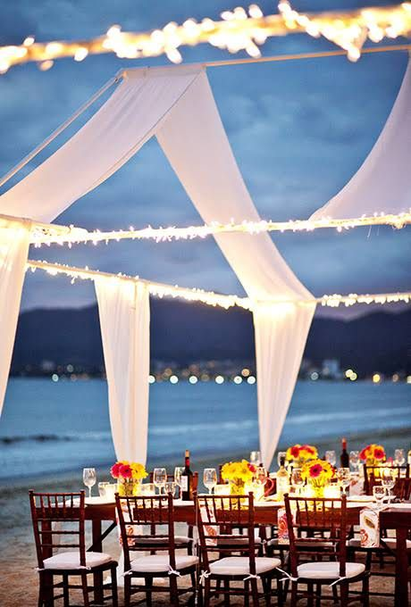 String lights framing an open tent structure - LOVE this idea