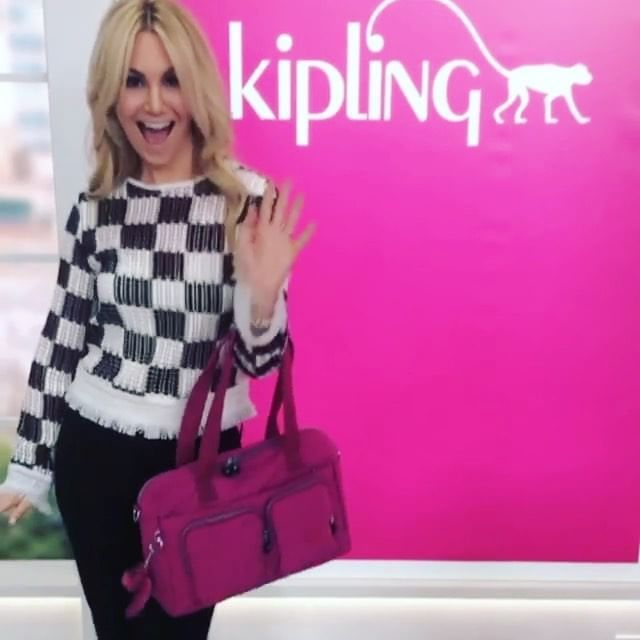 @rainaseitel is doing her happy-friday dance at @qvc today! tune in, we're live with exclusive styles all day long 🐒 [link in profile to learn more!] #mykipling #kipling #loveqvc #tgif