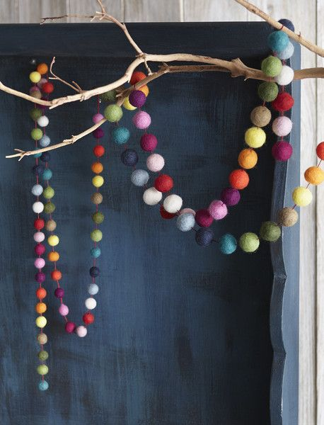 Have a ball decking the halls with our merry Jubilee Multicolor Garland from Roost!  Warm wool felt in a kaleidoscope of colors is crafted into spheres and then strung on thick red string to create an exuberant garland for any celebration.  This garland makes a wonderful accent to any child's room! $27.00