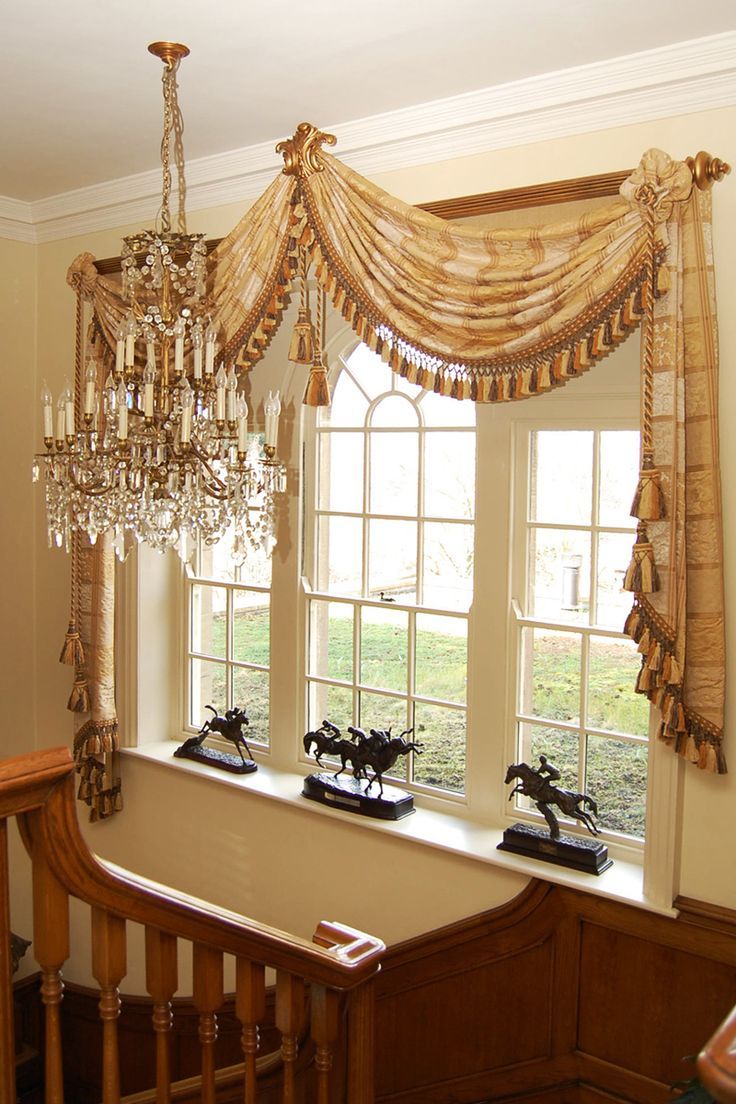 Drapery And Curtain Ideas: One Large Fringed Scarf Draped On Each Corner Of A Wooden