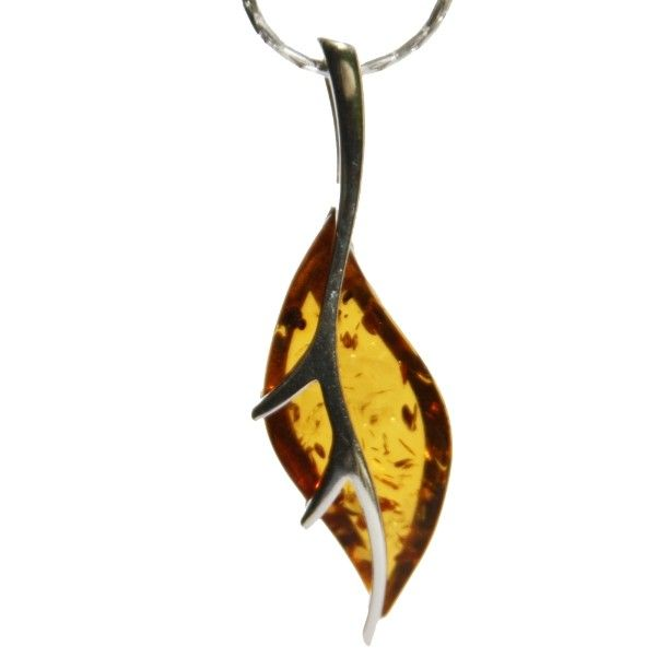 Lovely leaf shaped designer drop pendant featuring a sterling silver and elegant cognac amber piece. #leafjewellery #amberleaf #falljewellery #autumnjewellery #silverleaf #leafjewellery #amberpendant #uniquejewellery #oneofakind #oneoff