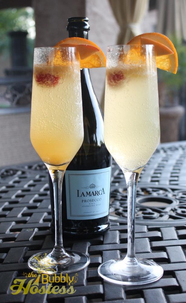 Garden of Eden cocktail {prosecco, peach puree, absolut mandarin} via The Bubbly Hostess