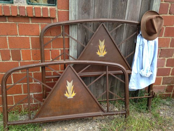 Vintage full size metal bed with loads of character. It's art deco meets summer camp!