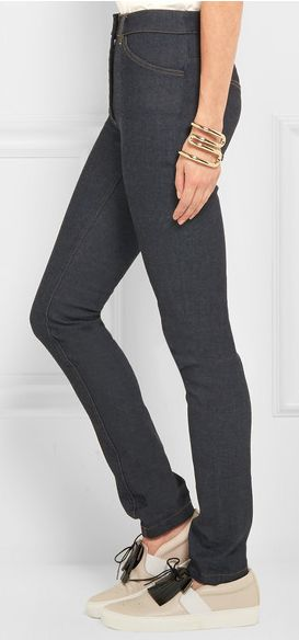 BALENCIAGA High-rise skinny jeans features a high waist that elongates your frame. This classic dark-blue stretch-denim pair feels flexible and hold its shape after every wear. Pairs best with heels or sneakers.