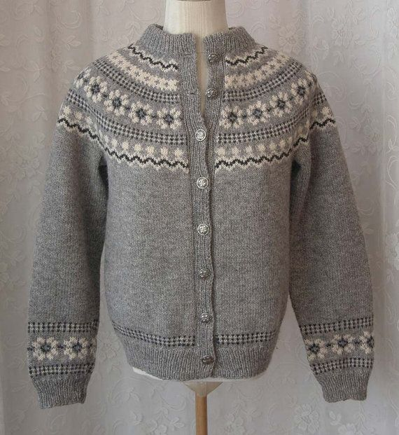 *DESCRIPTION: Gorgeous vintage (we are guessing 70s 80s) light gray fair isle sweater hand knit (or Husfliden) in Norway. Sweater features a Nordic design and the body is done in a light gray with the designs being done in white and black. Sweater buttons with pretty silver tone buttons decorated with flowers. Sweater features wide ribbing around collar, cuffs and hem. There are NO SEAMS on this sweater, it was knit as one piece (very difficult to do!) Label reads Handknitted, Husfliden…