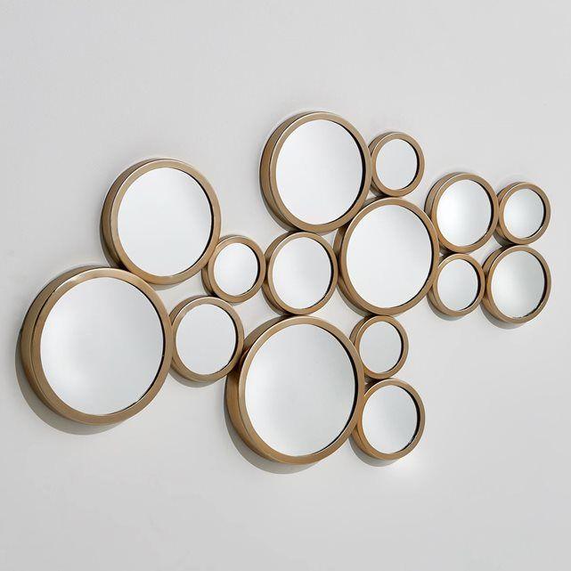 Ce miroir mural Kancona est composé de 4 miroirs soudés dans une armature   métallique, habillera votre mur d'un esprit fifties, très graphique.   Crochets pour fixation murale. L84 x H50 x P1,5 cm.