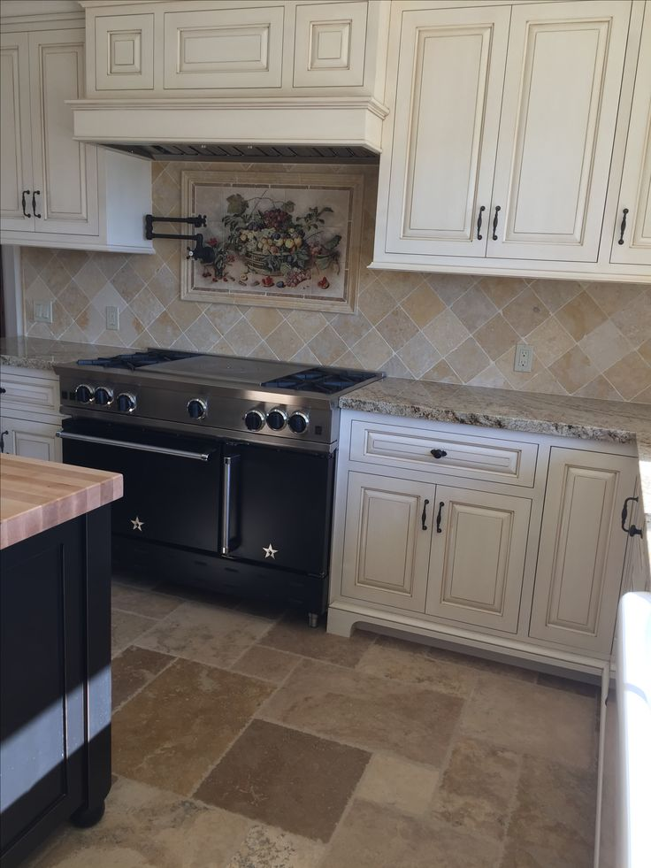 Tumbled stone backsplash and chiseled travertine | Kitchen