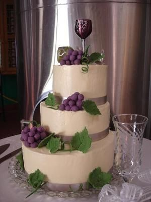 I think this Wine Themed Wedding Cake is very beautiful and elegant. Totally love the wine glass cake topper.