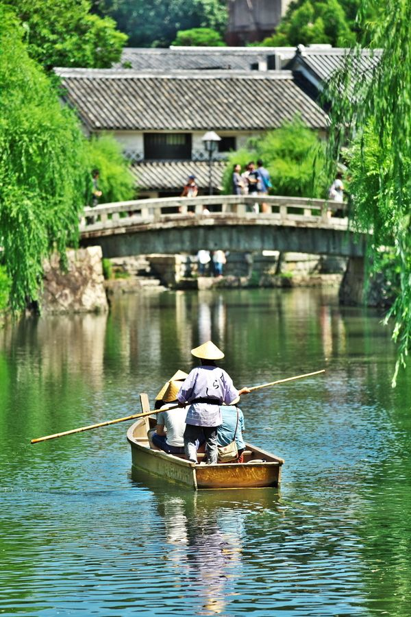 Kurashiki, Okayama, Japan. Located in Okayama Prefecture but way more worthy than the capital itself. Beautiful old town, canal and many shops full of great things to try. Also gardens, museums to visit around ? Day trip from Kyoto