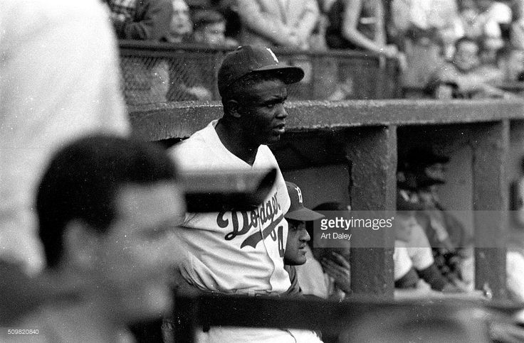 Brooklyn Dodgers Jackie Robinson (42) standing in front of dugout during game vs Pittsburgh Pirates at Ebbets Field. Art Daley X4143 )