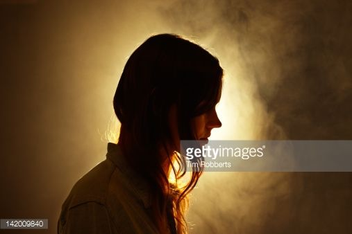 Foto stock : Young woman and smoke.