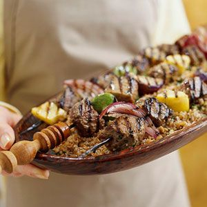 ... roast lamb with lamb sausage crust and fresh grape pan sauce recipe on