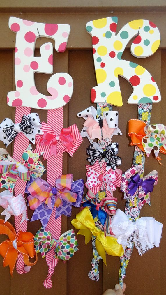 """for the female baby shower, order a initial bow holder, the dots replaced with the baby shower theme, and one of the """"games"""" can be a bow making station.. to fill up the initial holder =)"""