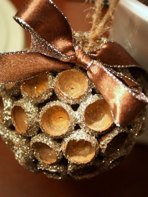"""Here is what you will need:  Acorn caps  Burnt Umber craft paint (and brush)  3"""" Styrofoam ball  Jute twine  Small piece of floral wire (18 gauge)  Narrow ribbon  Silver glitter (or your choice of color)  Mod Podge  Hot glue gun"""