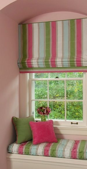 Fitted Roman shade covers the entire window area halting air circulation when shade is lowered. Using a white lining on the glass side will reflect light and heat back outside.