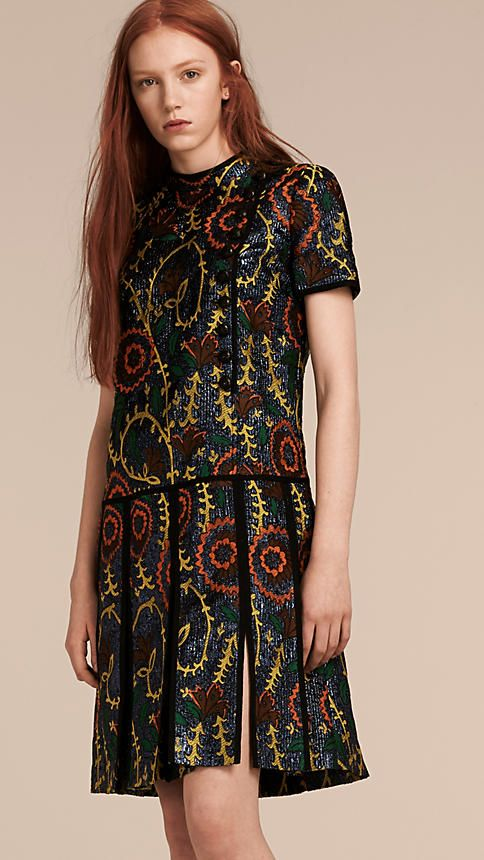 A floral jacquard Burberry dress with a drop wait and t-shirt top