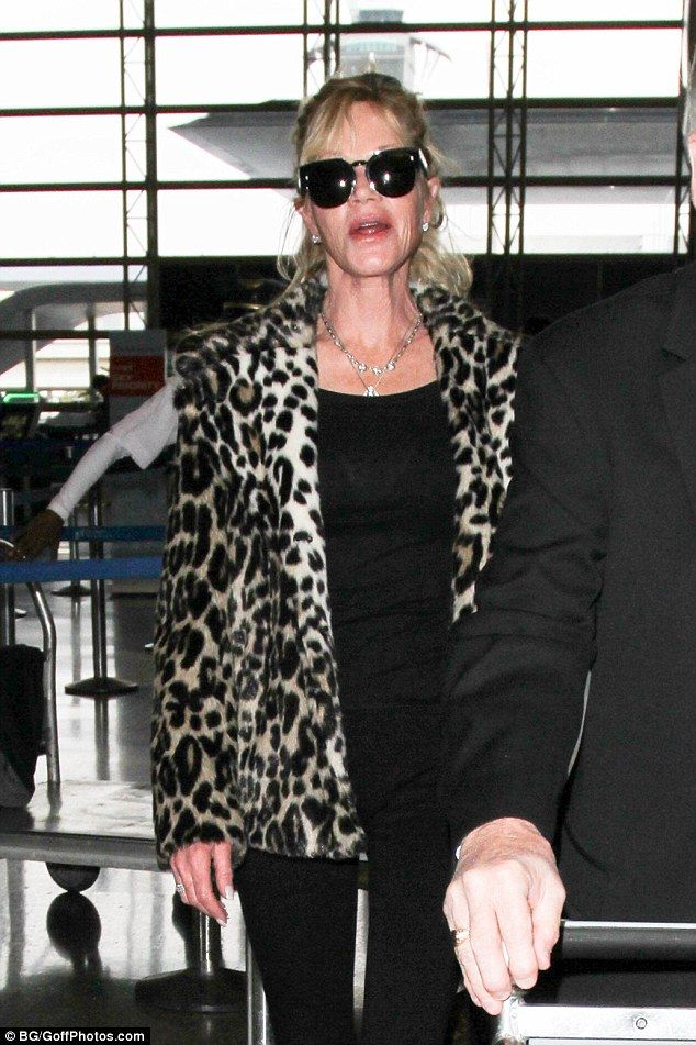 Glamorous: Melanie Grifith appeared to be sticking to her animal-friendly promise as she arrived at LAX airport in a faux fur leopard-print coat on Friday