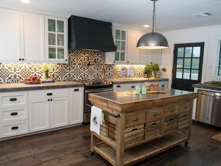 The recipe for this visually balanced kitchen includes plenty of natural wood to help soften the bold visual impact of the black-and-white patterned tile and the contrasting cabinets and countertops.