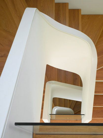 Curvaceous spiral staircase inside a period home. The curves give a contemporary feel to a victorian home.