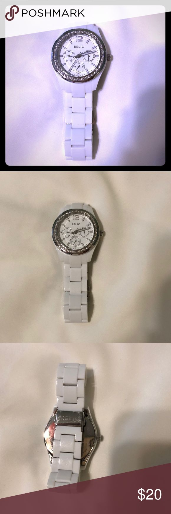 White Relic Watch with Crystals White Relic Watch with Crystals.   White Resin Band. Good condition. Crystals around face. Needs new battery. Relic Accessories Watches