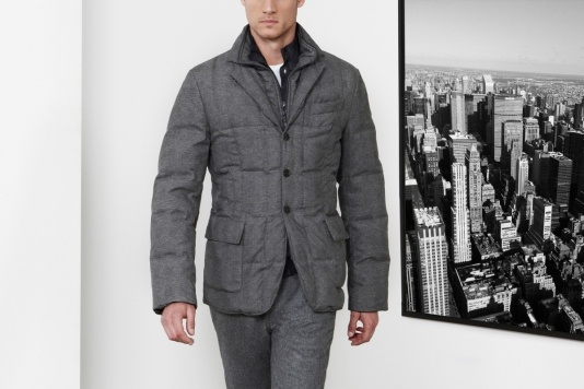 """Urban and stilish attitude for the """"double front"""" quilted down jacket in wool printed technical fabric. Available also in whole-coloured ultra light nylon with matt finishing."""