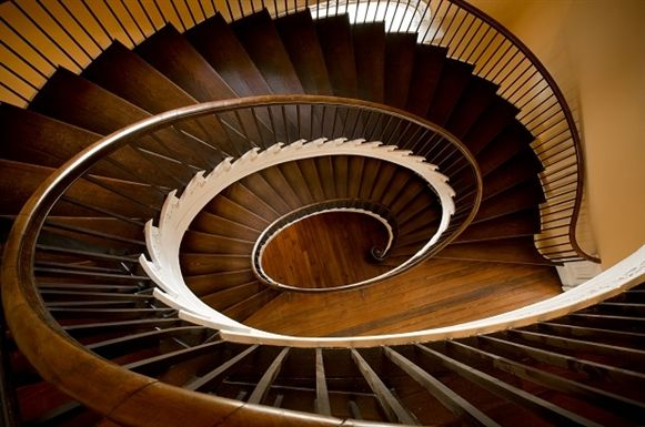 """Looking down the """"flying staircase"""" in the Nathaniel Russell House (in Charleston) - a view like the one from upstairs in Nicholai's home."""