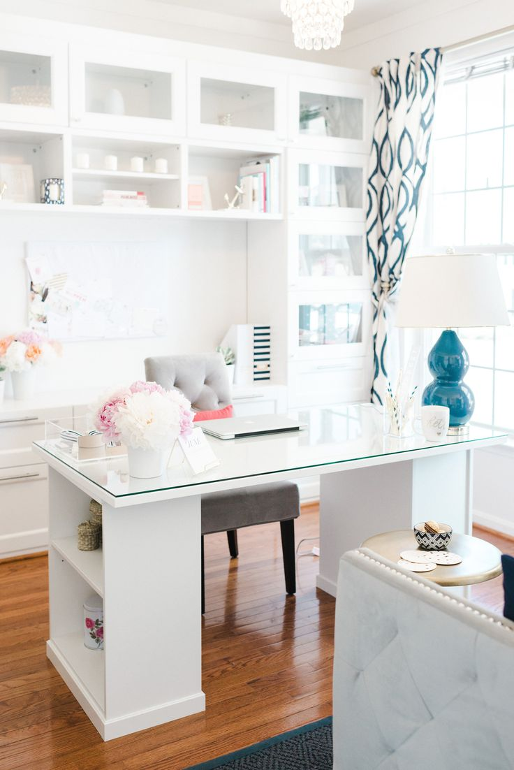 There is absolutely nothing better than a clean, sleek office space for productivity. We're absolutely in love with the way Lacoya Heggie, Owner and Lead Coordinator of Hello Love Events has decorated her office. With a base of sleek white, and pops of navy, gold, and pink, we're absolutely in love. Scroll on for more …