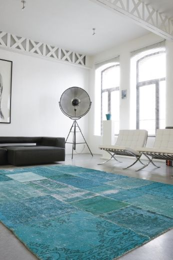 Swatches of various antique Turkish carpets are decolourized, redyed and sewn together to create a thoroughly modern, but decidedly bohemian patchwork. ...gorgeous green