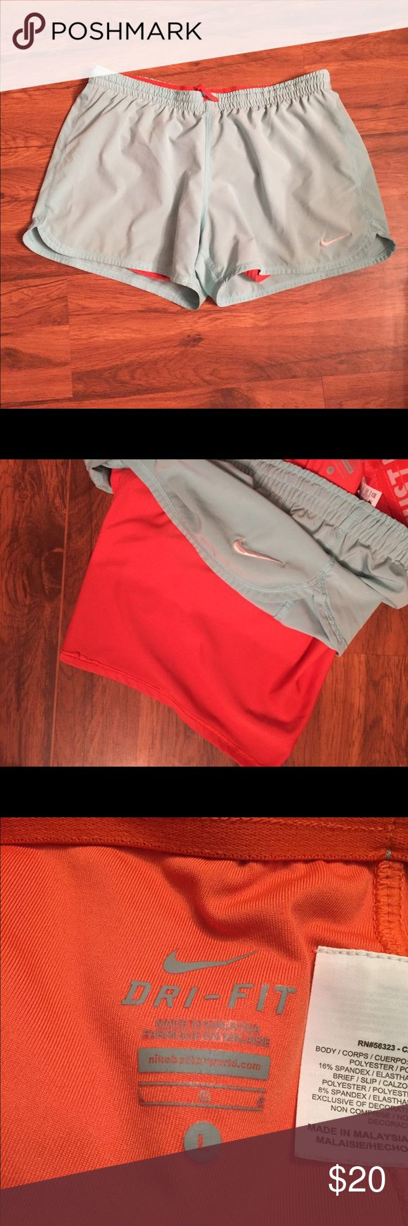 Nike Dri-Fit Compression Shorts Light blue Nike shorts with built in Orange compression underwear. Dri-fit and size large. Nike Shorts