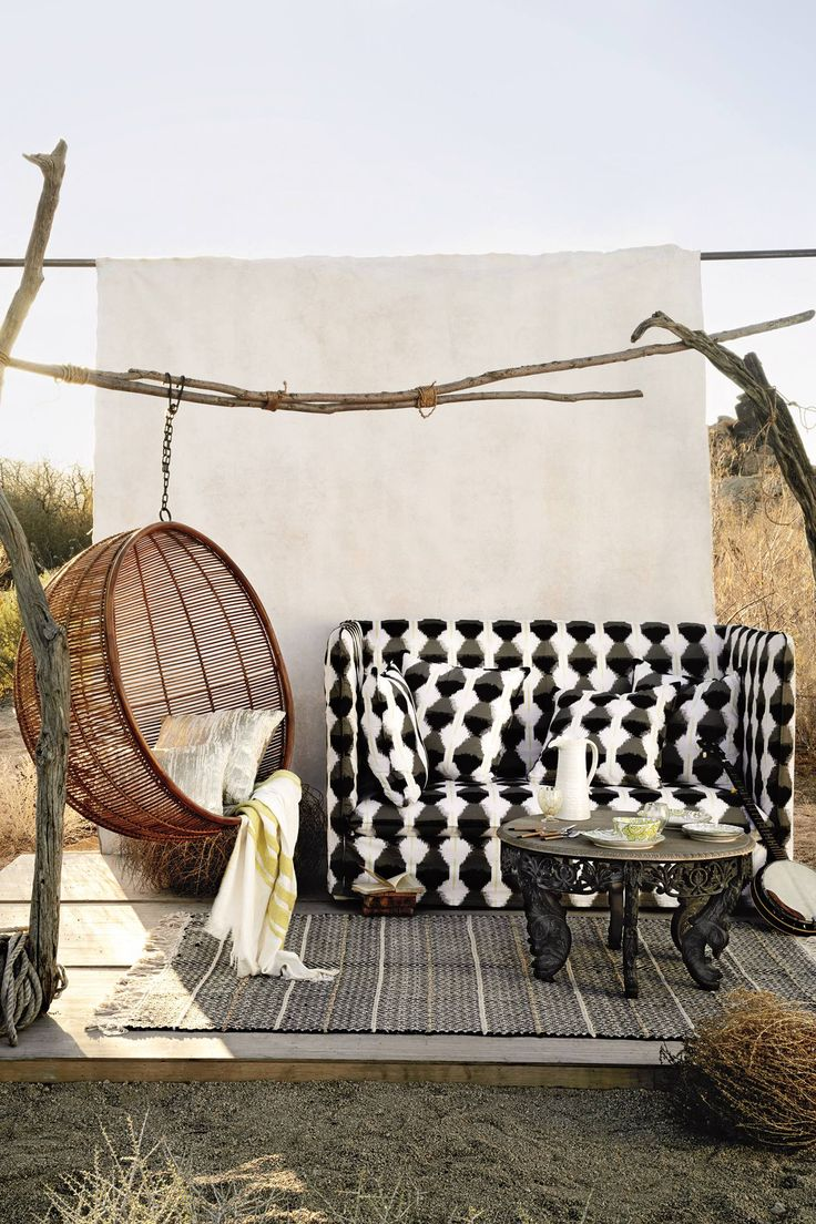 This quirky outdoor seating area is so good, especially Rattan Hanging Chair