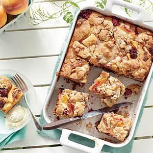 Toffee-glazed pecan pieces add a streusel-like crunch to the tops of these Blackberry-Peach Cobbler Bars.