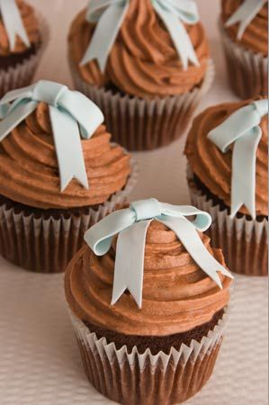 Aren't you sweet and simple 'Blue Bow and Chocolate' cupcakes - Chocolate fudge cake, Amedei Chuao chocolate and orange zest buttercream,  handmade sugar bows.